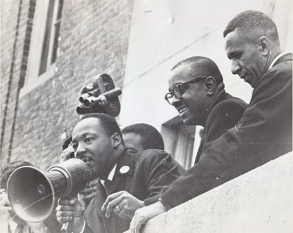 Left to right, the Rev. Dr. Martin Luther King Jr., the Rev. Virgil Wood, and the Rev. Gil Caldwell at Patrick Campbell Elementary School in the Roxbury section of Boston in April 1965. Photo courtesy of the Caldwell family collection