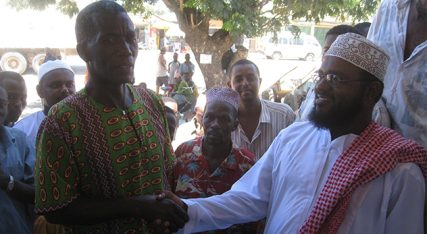 """""""No gays allowed"""": Christian pastor and Muslim Sheikh shake hands as they call on LGBT persons to leave town. – Image credit: BBC World Service (http://bit.ly/1cdySI6)"""