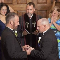 Aaron Huntsman (left) and William Lee Jones (right) are married in Key West, Fla., with the Rev. Steve Torrence officiating, the first couple to marry in the Florida Keys. Photo courtesy of REUTERS/Carol Tedesco/Florida Keys News Bureau // RNS-GAY-MARRIAGE, originally transmitted Jan. 28, 2015