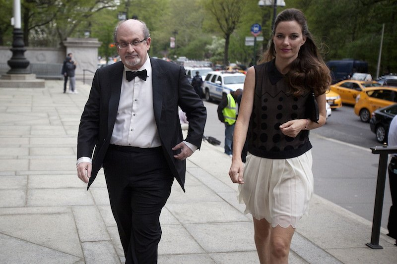 Author Salman Rushdie arrives with a guest for the PEN Literary Awards at the American Museum of Natural History in New York, May 5, 2015.