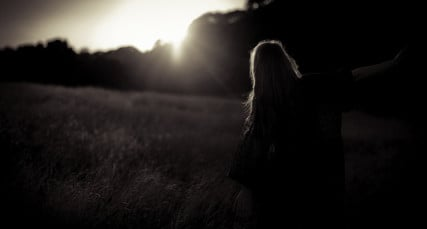 Female Silhouette in Field with Sunlight - courtesy of Image Catalog via Flickr