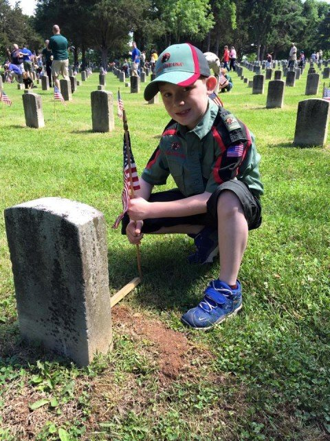 A trailman from Trail Life USA Troop Number 747 honoring the fallen. Photo courtesy of Troop TN-747