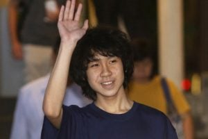 Amos Yee waves as he leaves the State Courts after his trial in Singapore May 12, 2015.