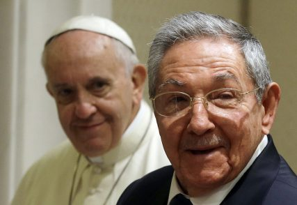 Cuban President Raul Castro (R) smiles as he meets Pope Francis during a private audience at the Vatican May 10, 2015.