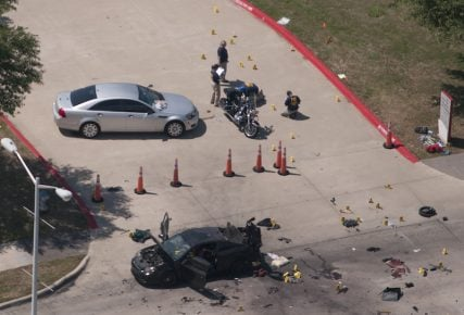 An aerial view shows the area around a car that was used the previous night by two gunmen, who were killed by police, as it is investigated by local police and the FBI in Garland, Texas