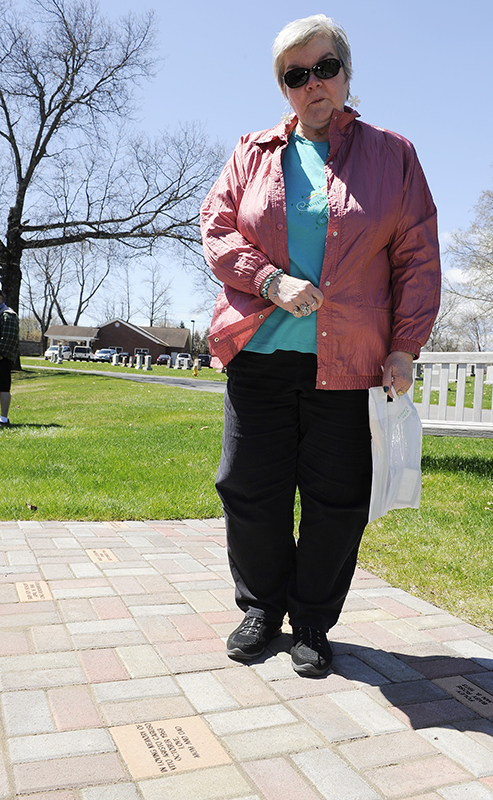 Dorothy Caruso of Schenectady, N.Y., poses for a photograph with a paver block in the memory of her son Vito Aristo Caruso, during a memorial service for mothers who lost their children before birth at the Most Holy Redeemer cemetery in Niskayuna, N.Y., on Tuesday, April 28, 2015. Photo by Hans Pennink / Special to Religion News Service