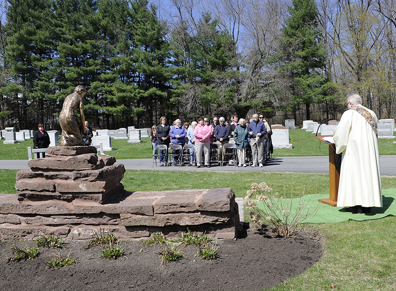 Deacon Jim O'Rourke from the The Cathedral of the Immaculate Conception in Albany, N.Y., right, speaks during a memorial service for mothers who lost their children before birth at the Most Holy Redeemer cemetery in Niskayuna, N.Y., on Tuesday, April 28, 2015. Photo by Hans Pennink / Special to Religion News Service