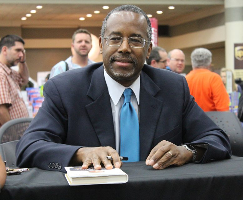 "Ben Carson signs his ""One Nation"" book in the exhibit hall of the Southern Baptist Convention annual meeting in Baltimore on June 11, 2014. Religion News Service photo by Adelle M. Banks"