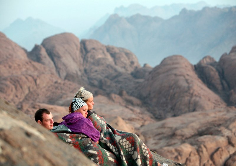 Visitors watch the sunrise from Mount Moses in the Sinai Peninsula on August 10, 2009. According to the Bible, this was where Moses received the ten commandments from God. Photo courtesy of REUTERS/Goran Tomasevic *Editors: This photo may only be republished with RNS-BLECH-COLUMN, originally transmitted on May 21, 2015.