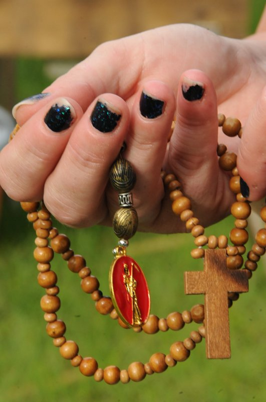 A detail of Tammy Bloome's Santa Muerte rosary. The handmade rosary wooden beads feature a wooden cross and a metal Santa Muerte. Religion News Service photo by Dede Smith