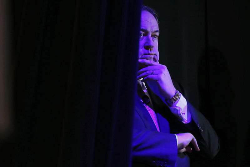 Former Governor of Arkansas Mike Huckabee listens to his introduction from the side of the stage at the Freedom Summit in Des Moines, Iowa, on January 24, 2015. Photo courtesy of REUTERS/Jim Young *Editors: This photo may only be used with RNS-HUCKABEE-EVANGEL, originally transmitted on May 6, 2015.