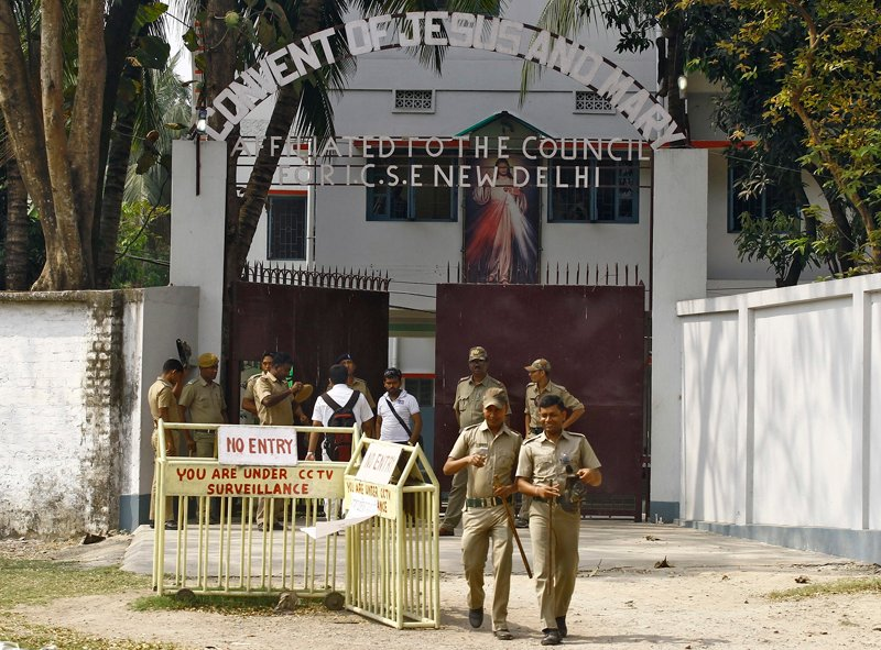 Police stand guard outside the Convent of Jesus and Mary school in Ranaghat in the eastern Indian state of West Bengal on March 18, 2015. In the days before the rape of an elderly nun in an armed assault that has shaken India, death threats and extortion attempts had already shattered the peace at her Convent of Jesus and Mary school, police and school officials say. The attack also comes amid a trend of worsening security for India's Christian minority, less than one year since the government of Hindu nationalist Prime Minister Narendra Modi came to power. Photo courtesy of REUTERS/Rupak De Chowdhuri *Editors: This photo may only be republished with RNS-INDIA-CHRISTIANS, originally transmitted on May 27, 2015.