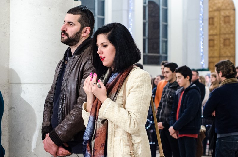 Catholics from the local and international community attend Christmas Eve mass at Mother Teresa Cathedral in Pristina, Kosovo, to mark the birth of Jesus Christ. There are about 65,000 Catholics in Kosovo, a country which is predominately Muslim. Religion News Service photo by Valerie Plesch