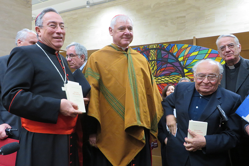 "Left to right, Cardinal Oscar Rodriguez Maradiaga of Tegucigalpa, Honduras; German theologian, Cardinal Gerhard Mueller, head of the Vatican's Congregation for the Doctrine of the Faith; and the Rev. Gustavo Gutierrez, during a news conference to unveil Mueller's book ""Poor for the Poor: The Mission of the Church"" on February 25, 2014 in Rome. Religion News Service photo by David Gibson"