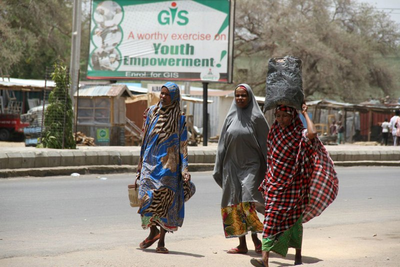 Women flee with their belongings on the road in Maiduguri in Borno State, Nigeria on May 14, 2015. Photo courtesy of REUTERS/Stringer *Editors: This photo may only be republished with RNS-NIGERIA-MUSLIM, originally transmitted on May 27, 2015.