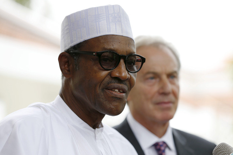 Nigeria's President-elect Muhammadu Buhari addresses the media during former British Prime Minister Tony Blair's visit at the Defence House in Abuja, Nigeria, on May 13, 2015. Photo courtesy of REUTERS/Afolabi Sotunde *Editors: This photo may only be republished with RNS-NIGERIA-MUSLIM, originally transmitted on May 27, 2015.