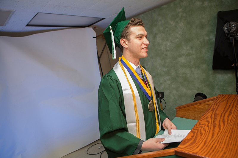 Don Greenberg, student speaker for Watson School of Engineering and Applied Sciences commencement and an Orthodox Jew, pre-records his commencement speech with help from video producer Andrew Hatling. Greenbergs' recorded speech will be played during the Watson ceremony which falls on Saturday, May 16, 2015, the Sabbath, which Orthodox Jews do not use electronic devices such as a microphone, so that he can observe the holy day. Photo courtesy of Jonathan Cohen/Binghamton University