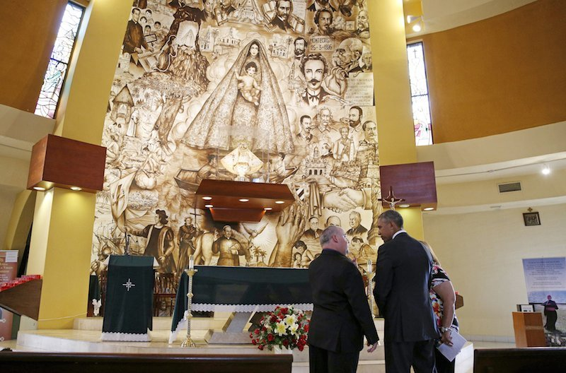 U.S. President Barack Obama visits the Shrine of Our Lady of Charity in Miami, Florida May 28, 2015. Giving Obama the tour is Father Juan Rumin Dominguez (L).  Photo by Kevn Lamarque courtesy of Reuters.