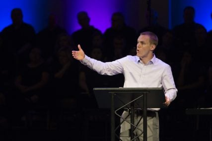 """IMB President David Platt challenges the congregation at Highview Baptist Church in Louisville, Kentucky to go to unreached people living in hard places because we have an """"incomprehensibly glorious God."""" Photo courtesy of IMB"""