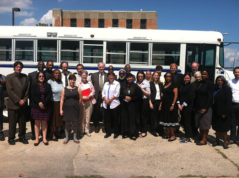 The Interfaith Delegation stand in front of the bus during a trip to Rikers Island Jail Complex on August 26, 2014. Photo courtesy of NRCAT