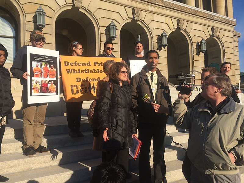 Phoebe Jones of Crossroads Women Center, Philadelphia, center left, and Derrick Stanley, one of the Dallas 6, center right, hold a press conference on Nov. 10, 2014 at Luzerne County Courthouse. Photo courtesy of Lynne Iser