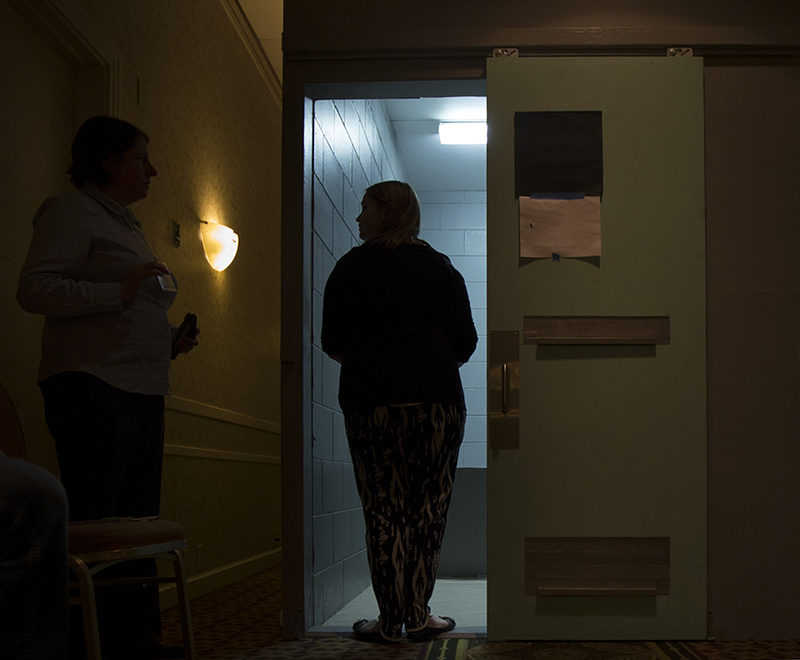 A person stands in the doorway of a replica SHU cell on April 19, 2015, during Ecumenical Advocacy Days. Photo by Erin Schaff, courtesy of Perisphere Media - www.PerisphereMedia.com