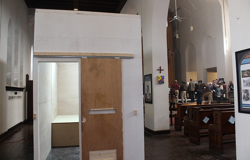 As church members concluded their worship service, a replica of a solitary confinement cell stood in the sanctuary of St. Stephen and the Incarnation Episcopal Church in Washington, D.C., on March 22, 2015. The National Religious Campaign for Torture placed it there to build awareness about solitary confinement. Religion News Service photo by Adelle M. Banks