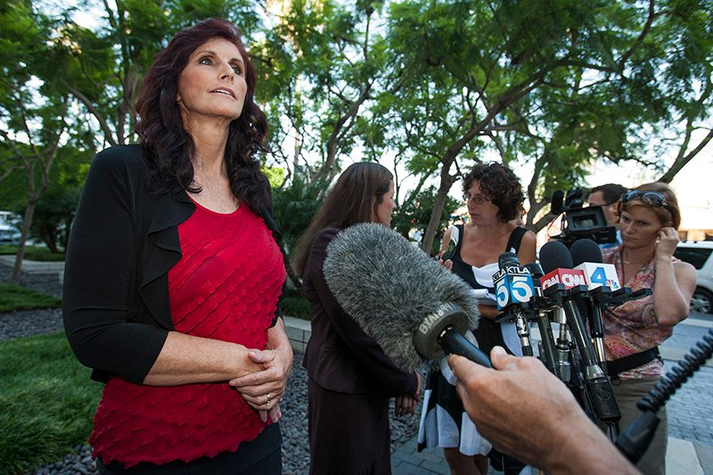 """Cindy Lee Garcia, left, an actress in the """"Innocence of Muslims"""", an anti-Islam movie that has spawned violent protests across the Muslim world, holds a news conference outside her attorney's office after a court hearing in Los Angeles, California on September 20, 2012. Photo courtesy of REUTERS/Bret Hartman  *Editors: This photo may only be republished with RNS-YOUTUBE-VIDEOS, originally transmitted on May 20, 2015."""