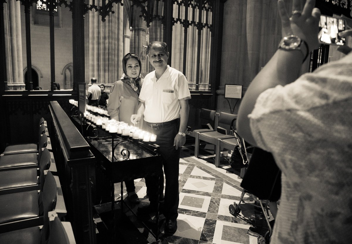 A couple lights a candle inside the Washington National Cathedral on June 12, 2015. Religion News Service photo by Sally Morrow