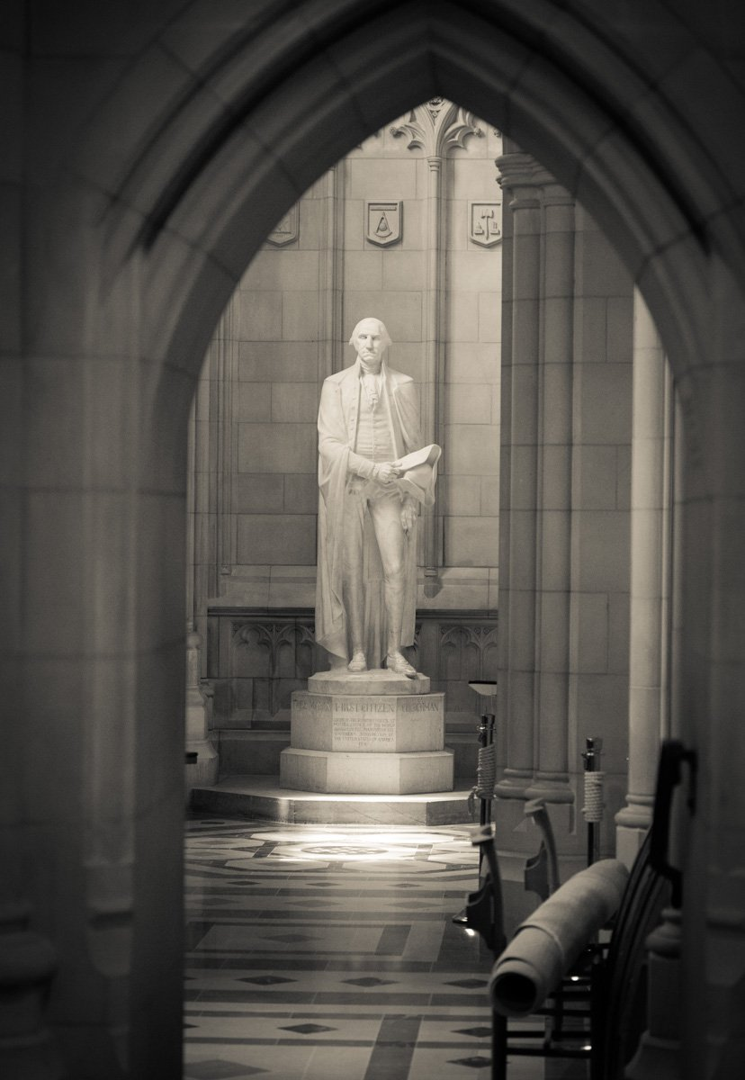 A statue of George Washington is draped in sunlight through an archway inside the Washington National Cathedral on June 12, 2015. Religion News Service photo by Sally Morrow