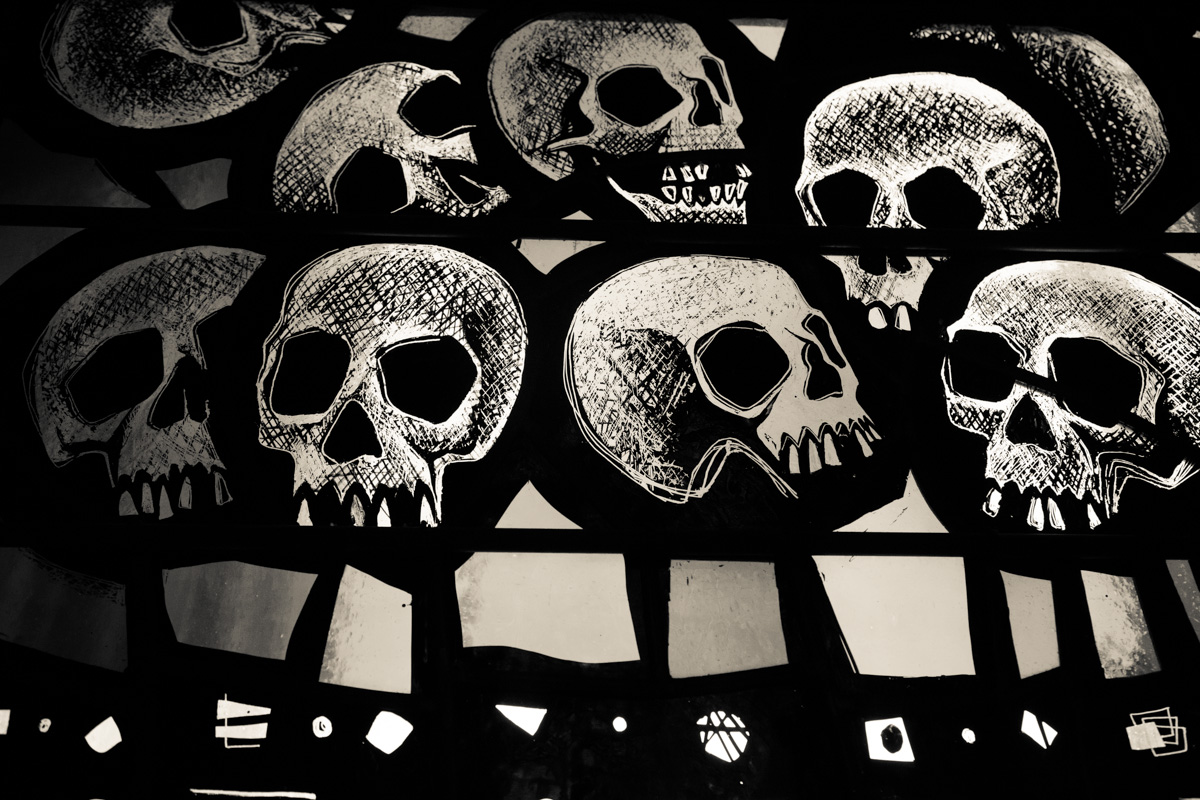 Sun shines through details of skulls on a stained glass window that depicts the story of Noah's Ark inside the Washington National Cathedral on June 12, 2015. Religion News Service photo by Sally Morrow