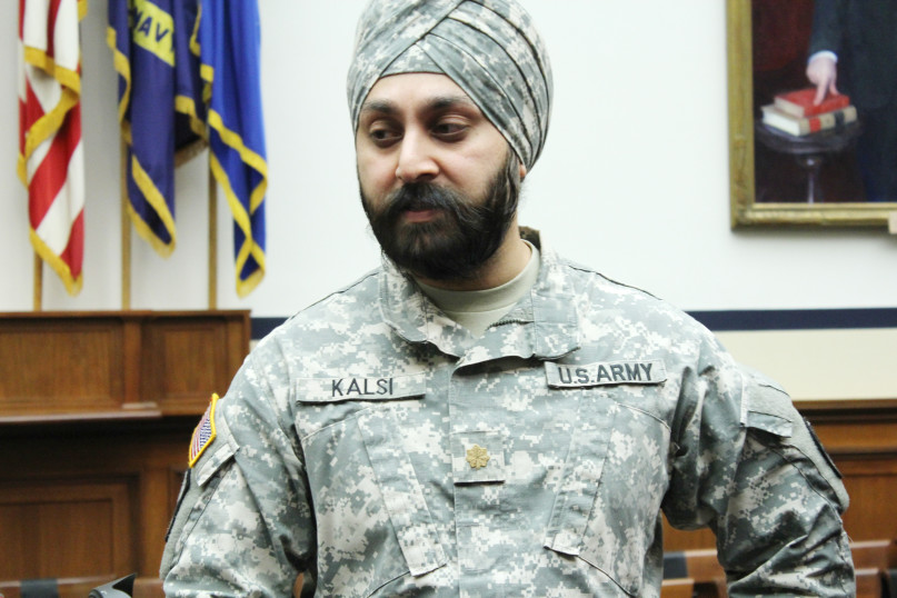 Army Maj. Kamaljeet Singh Kalsi attends a congressional briefing on religious liberty, while wearing a camouflage turban, Jan. 8, 2014, in Washington. RNS photo by Adelle M. Banks