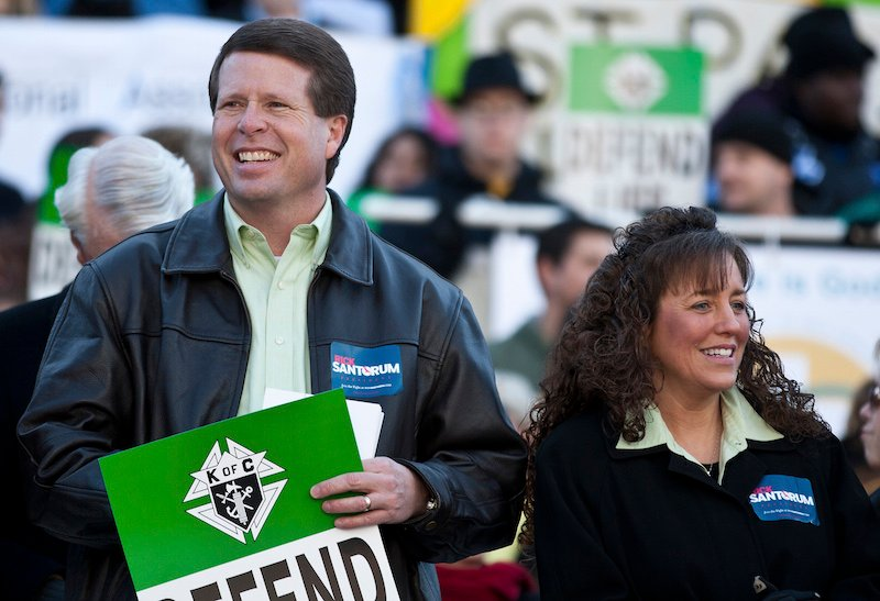 im Bob Duggar (L) and his wife Michelle Duggar (R), supporters of Republican presidential candidate and former Pennsylvania Senator Rick Santorum, attend a Pro-Life rally in Columbia, South Carolina, on the steps of the State House January 14, 2012.