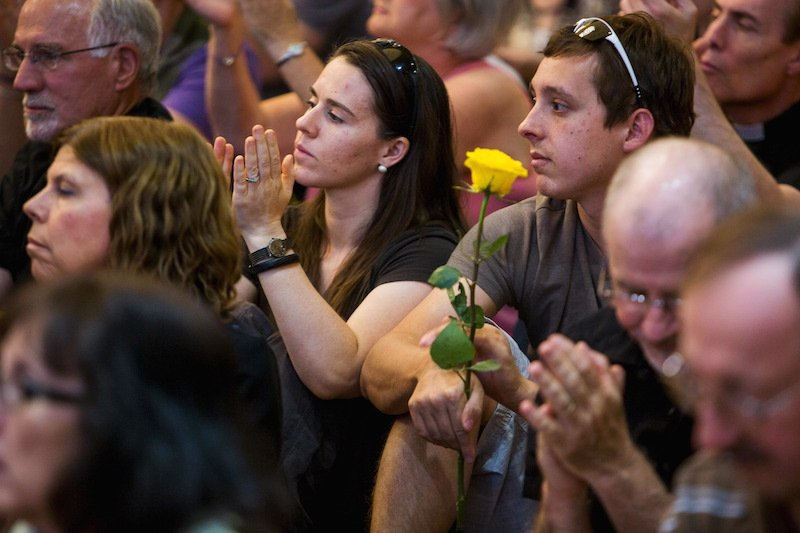 "Attendees listen as speakers from different faiths speak at an interfaith rally titled ""Love is Stronger than Hate"" at the Islamic Community Center in Phoenix, June 1, 2015."