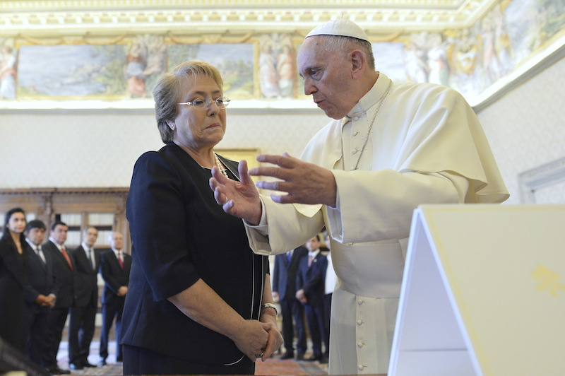 Pope Francis talks with Chile's President Michelle Bachelet during a private audience at the Vatican, June 5, 2015.