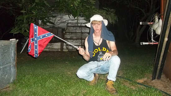 Dylann Roof, posing with Confederate battle flag
