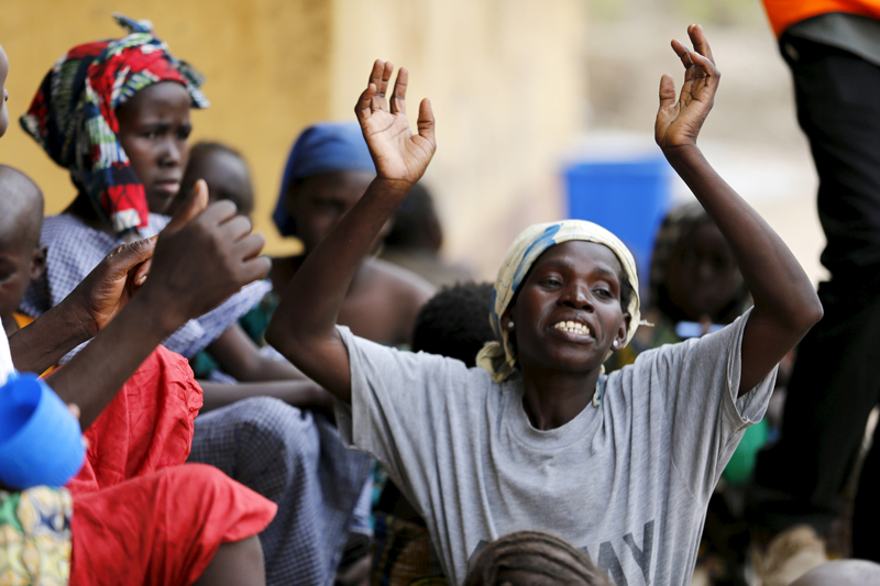 A woman rescued from Boko Haram in Sambisa forest is seen celebrating her freedom at Malkohi camp for Internally Displaced People in Yola, Adamawa State, Nigeria on May 3, 2015. Hundreds of traumatised Nigerian women and children rescued from Boko Haram Islamists have been released into the care of authorities at a refugee camp in the eastern town of Yola, an army spokesman said. Photo courtesy of REUTERS/Afolabi Sotunde *Editors: This photo may be republished with RNS-ABORTION-FUNDS, originally transmitted on June 3, 2015.