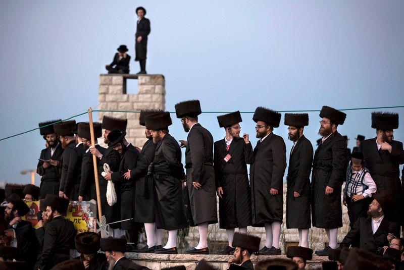 Ultra-orthodox Jews watch the wedding ceremony of Esther Rokeach and Avraham Safrin (not pictured) in Jerusalem on June 10, 2014. Thousands gathered on Tuesday to celebrate the wedding between Safrin and Rokeach, the grand daughter of the spiritual leader of the Belz Hasidim, which is one of the largest Hasidic movements in the world. Photo courtesy of REUTERS/Baz Ratner  *Editors: This photo may be republished with RNS-BELZ-DRIVE, originally transmitted on June 1, 2015.