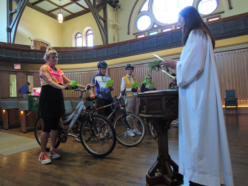 Officiant Ann Russell presides over the sixth annual Blessing of the Bikes at Toronto's Trinity-St. Paul's United Church on June 7, 2015. Religion News Service photo by Ron Csillag