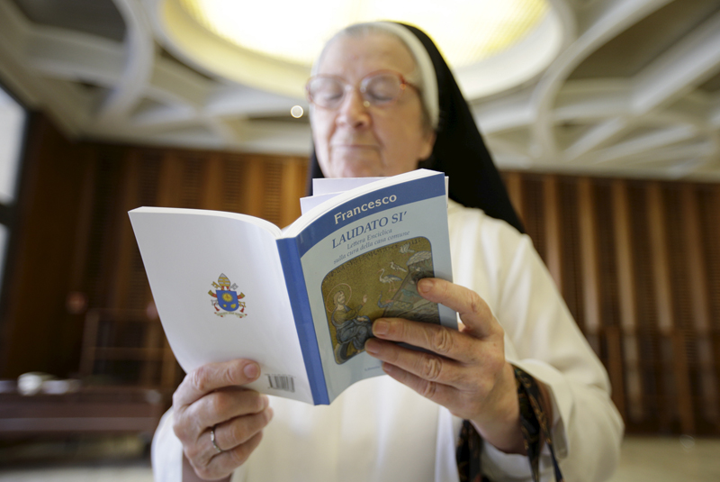 A nun reads Pope Francis' new encyclical titled 'Laudato si' at the Vatican on June 18, 2015. Photo courtesy of REUTERS/Max Rossi *Editors: This photo may only be republished with RNS-BISHOPS-ENCYCLICAL, originally transmitted on June 18, 2015.