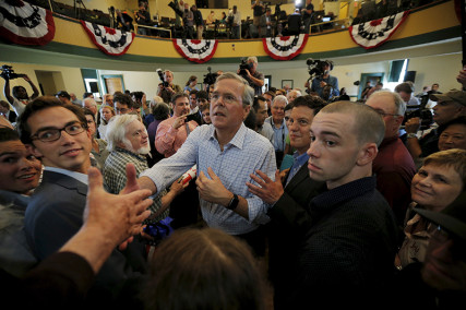 Republican presidential candidate Jeb Bush greets an audience member following a campaign town-hall meeting in Derry, New Hampshire on June 16, 2015. Photo courtesy of REUTERS/Brian Snyder *Editors: This photo may only be republished with RNS-BUSH-POPE, originally transmitted on June 17, 2015.