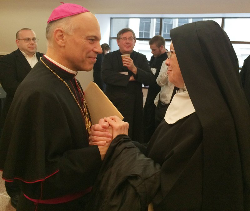 """San Francisco Archbishop Salvatore Cordileone speaks with a nun after his talk on Wednesday, June 3, 2015 in New York in which he criticized """"gender ideology"""" as a threat to society and the church."""" Religion News Service photo by David Gibson"""