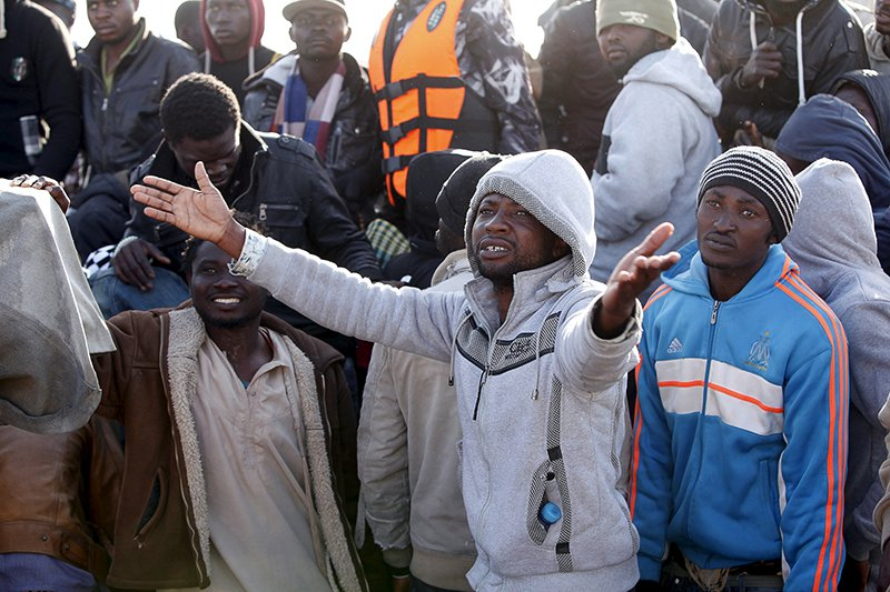 A migrant reacts next to others after their boat was sent back by the Libyan navy to the coastal city of Misrata on May 3, 2015. Nearly 5,800 migrants were plucked from boats off the coast of Libya and 10 bodies were recovered in less than 48 hours, Italy's coast guard said, in one of the biggest rescue operations this year. Libyan state news agency Lana said authorities there detained 500 migrants in five boats off Tripoli and a further 480 migrants - from Sudan, Somalia, Eritrea and Ethiopia were caught in a farm near the central town of Jufra, and another 170 were detained nearby. Photo courtesy of REUTERS/Ismail Zitouny *Editors: This photo may only be republished with RNS-ERITREA-UN, originally transmitted on June 10, 2015.