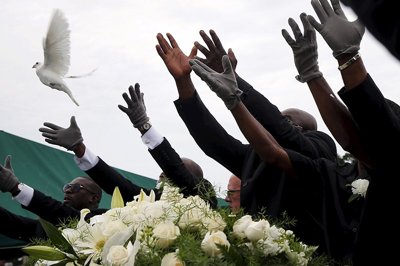 Pall bearers release white doves over the casket of Ethel Lance as she is buried at the Emanuel African Methodist Episcopal Church cemetery in North Charleston, South Carolina on June 25, 2015.  Lance is one of the nine victims of the mass shooting at the Emanuel African Methodist Episcopal Church. Photo courtesy of REUTERS/Brian Snyder *Editors: This photo may only be republished with RNS-FAITH-FORGIVE, originally transmitted on June 25, 2015.