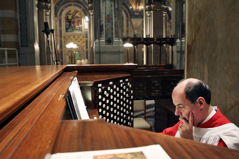 John Romeri takes a moment during Mass on August 8, 2010 at the Cathedral Basilica of St. Louis. Photo by Erik M. Lunsford, courtesy of St. Louis Post-Dispatch