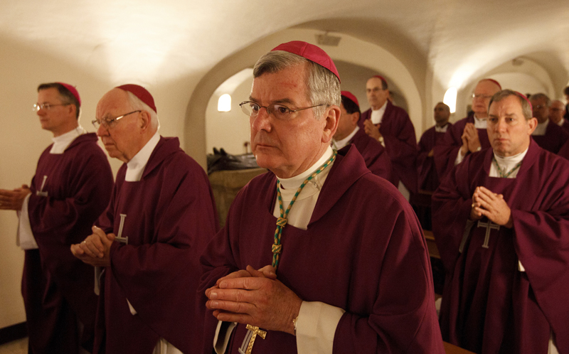 Archbishop John C. Nienstedt of St. Paul and Minneapolis, center, and other bishops from Minnesota, North Dakota and South Dakota concelebrate Mass at the Altar of the Tomb in the crypt of St. Peter's Basilica at the Vatican on March 9. Photo by Paul Haring, courtesy of Catholic News Service