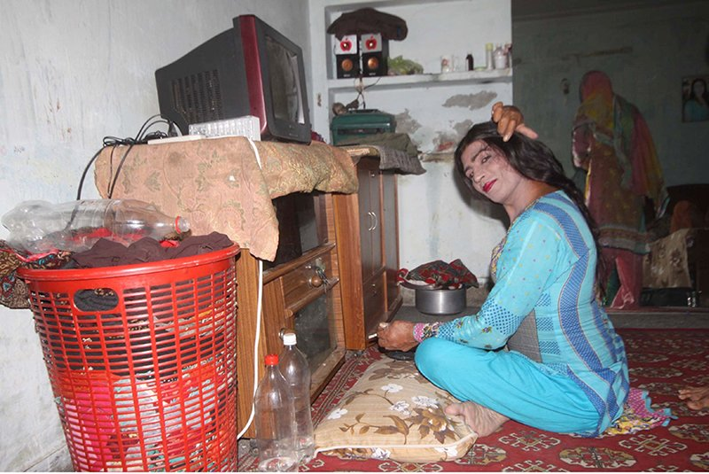 """Rakha"" sits for a portrait after being interviewed in her living space. Religion News Service photo by Yasir Habib Khan"