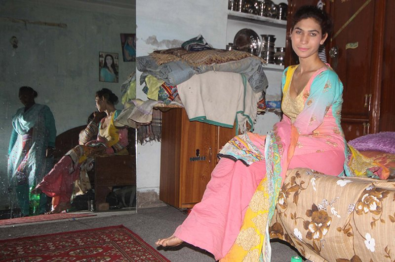 "Javed, who goes by ""Chandani,"" poses for a portrait in her living space. Religion News Service photo by Yasir Habib Khan"