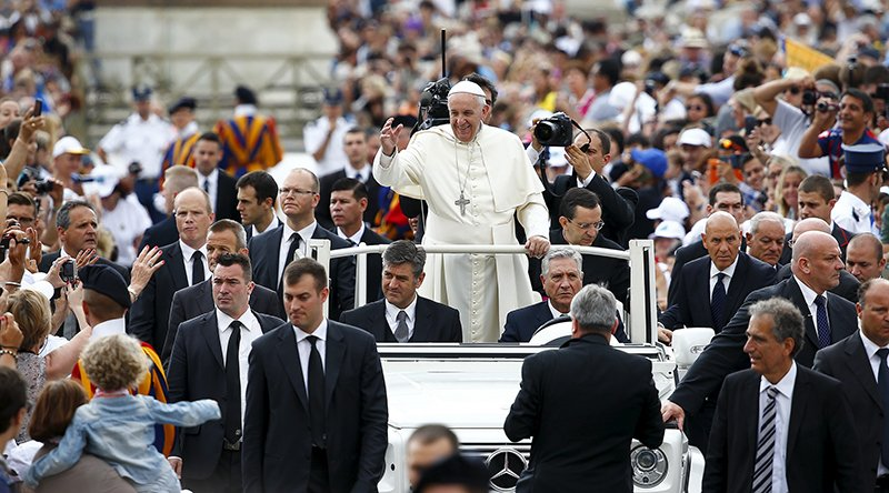 Pope Francis waves as he arrives to lead the weekly audience in Saint Peter's Square at the Vatican on June 24, 2015. Photo courtesy of REUTERS/Tony Gentile *Editors: This photo may only be republished with RNS-POPE-DIVORCE, originally transmitted on June 24, 2015.