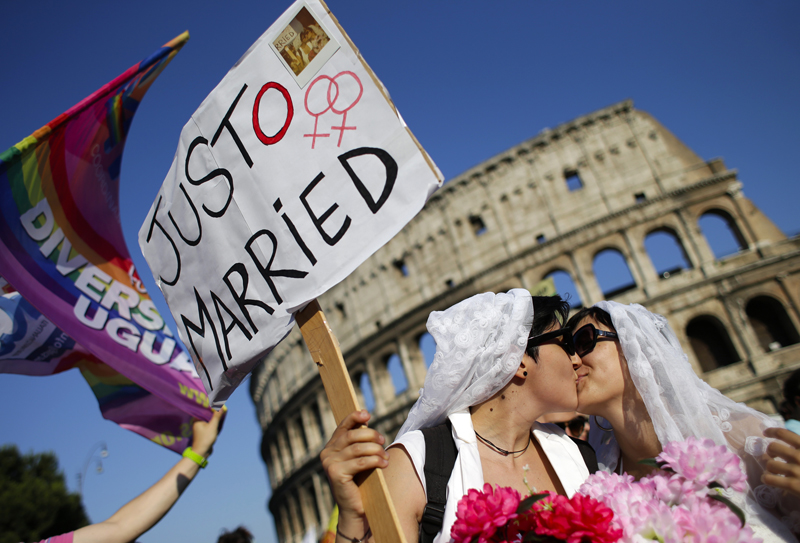 A lesbian couple kiss in front of the Colosseum during the annual gay pride parade in downtown Rome on June 15, 2013. Photo courtesy of REUTERS/Max Rossi *Editors: This photo may only be republished with RNS-POPE-GAYPRIDE, originally transmitted on June 15, 2015.